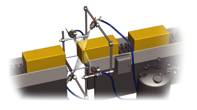 nozzles spraying blocks of cheese on conveyor