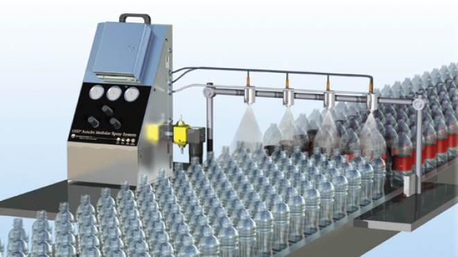 lubricant being sprayed on plastic bottles on conveyor